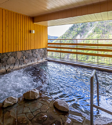 Japan SounkyoOnsen HotelTaisetsu Grand public bath with a view TAISETSU
